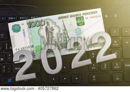 Close-up. Black Background. On It Are Numbers 2022 And A Bill Of 1000 Rubles. Russia.