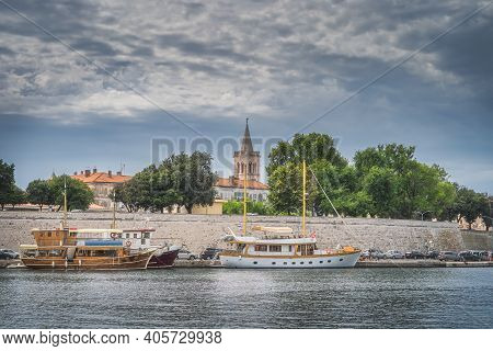 Marina With Moored Sailboats In Zadar Bay. Fortification, Walled Old Town And Belltower Of Church Of