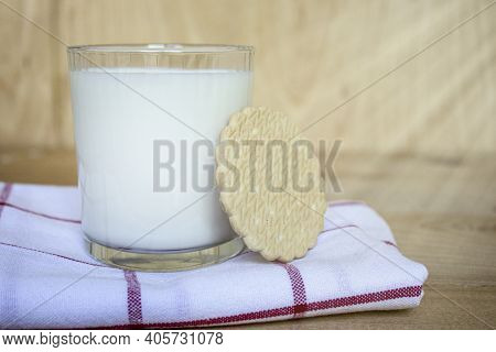 Tasty Fresh Milk On A White Wooden Background. A Glass Of Milk. Milk And Biscuits. Breakfast. Copy S