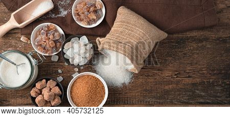 A Variety Of Sucrose Varieties On A Natural Wooden Background.