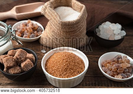 Cane Sugar, Refined Sugar, White And Lollipop Sugar On A Wooden Background.
