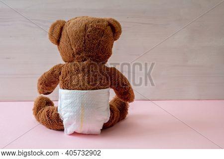 Baby Girl, Teddy Wearing Diaper On Pink Color Floor