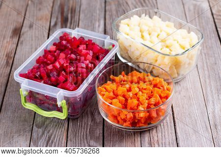 Chopped Vegetables In Containers. Storage Of Prepared Foods In Plastic Container. Vegetables For Fre