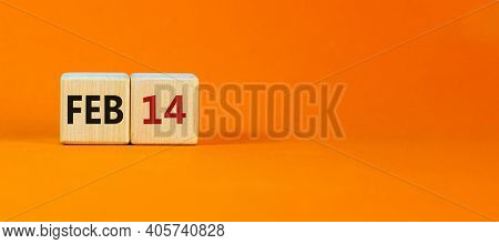 February 14 Valentines Day Symbol. Wooden Cubes With Words 'feb 14'. Beautiful Orange Background, Co