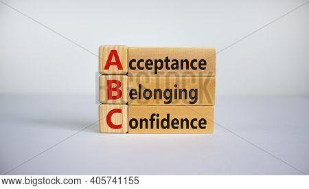 Acceptance, Belonging, Confidence Symbol. Wooden Cubes With Words 'acceptance, Belonging, Confidence