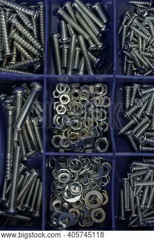Factory Equipment And Industrial Concept. Macro View Of Pile Of Internal Screws, Background Or Textu