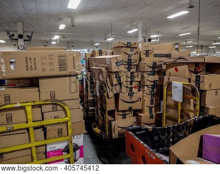 Oshkosh, Wi - 14 June 2020:  Amazon Packages Loaded Up On Pipe Trucks At Either Ups Amazon Delivery,