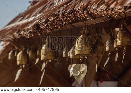 Buddhist Bells On Temple Building In Phuket. Religious Landmark At Resort In Thailand. Tourist Place