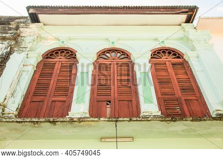 Antique Shuttered Windows In Antique House In Phuket, Viewed From Below. Old Town In Thailand. Vinta