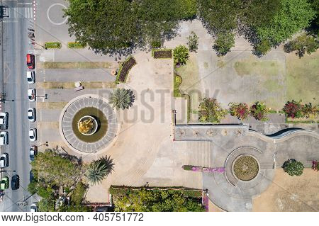 Top View Aerial Photo From Flying Drone Of A City Park With City Park Gardening Top Down View.
