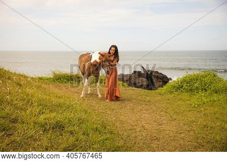 Woman Leading Horse By Its Reins. Horse Riding. Human And Animals Relationship. Traveling Concept. C