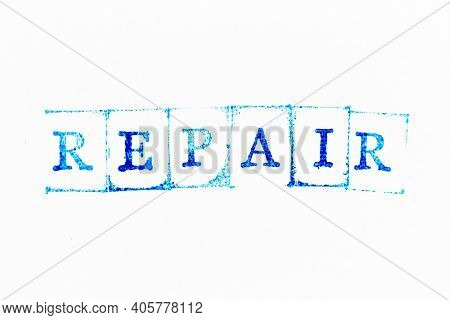 Blue Color Ink Rubber Stamp In Word Repair N White Paper Background