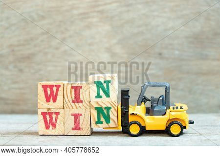 Toy Forklift Hold Letter Block N To Complete Word Win Win On Wood Background