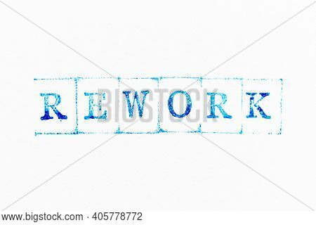 Blue Color Ink Rubber Stamp In Word Rework On White Paper Background