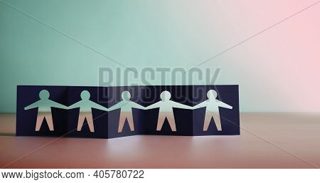 Teamwork, Partnership, Humanity And Unity Concept. Human Sign Shape Cut Out On Fold Paper, Metaphor
