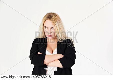 Studio Portrait Of Blonde Girl Isolated On White Background. Reference Of An Angry And Arrogant Girl
