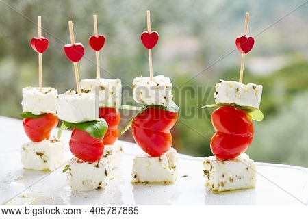 Valentines Day Or Birthday Romantic Snacks.canapes With Cheese And Heart-shaped Piccadilly Tomatoes.