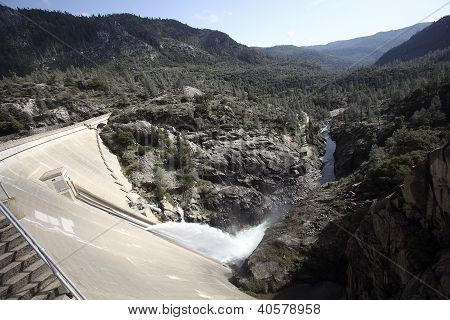 The manmade Hetch Hetchy Reservoir in Yosemite National Park provides water to the city of San Francisco through a gravity-fed pipe system that spans California's vast central valley. poster
