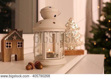 Decorative Christmas Lantern With Burning Candle On Windowsill