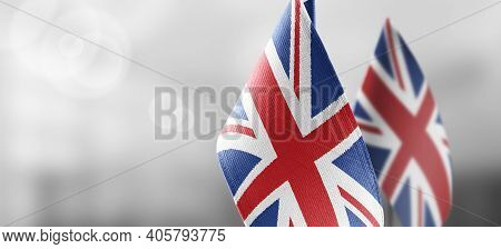 Small National Flags Of The United Kingdom On A Light Blurry Background