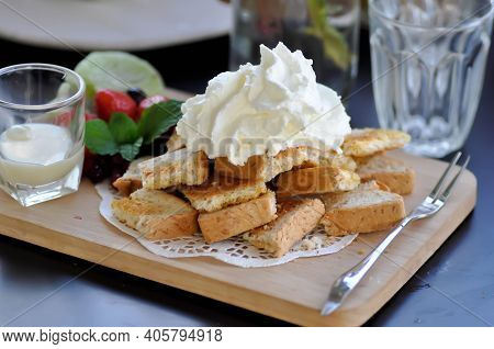 Toast ,butter Toast Or Toast With Fruit And Whipping Cream