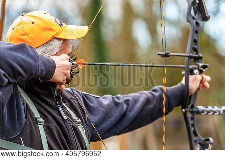 Verona, Italy - December 22, 2019: Close-up Of A Male Archer Aiming With A Hunting Compound Bow, Wit