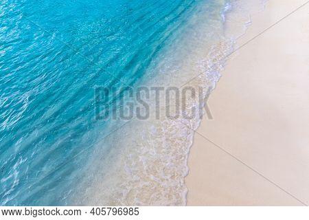 Soft Wave Of Blue Ocean On Sandy Beach. Close-up Soft Wave Of The Sea On The Sandy Beach, Relaxing N