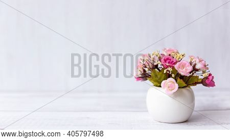 Pink Rose Flower On Wood Shelf White Background.   Copy Space For Text. Still Life And Lifestyle Con