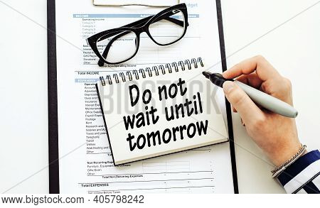 Do Not Wait Tomorrow - Text Written By Business Woman In Her Diary On Office Desk.