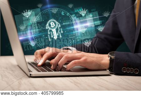 business hand working in stock market with blockchain icons coming out from laptop screen