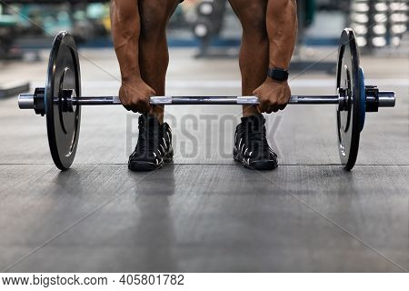 Powerlifting, Bodybuilding Concept. Cropped Of Black Muscular Man Hands Lifting Weights In Gym. Unre