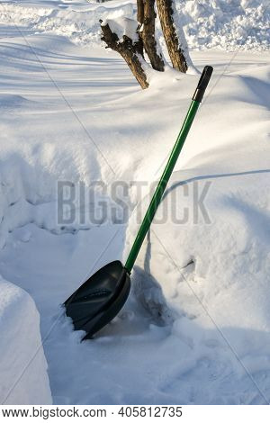 Snow Removal. Snow Shovel Surrounded By Large Snow Drifts. Utilities For Winter Road Cleaning. Shove