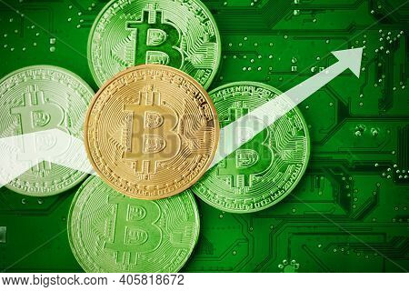 Golden Bitcoins On A Mainboard. Top View.