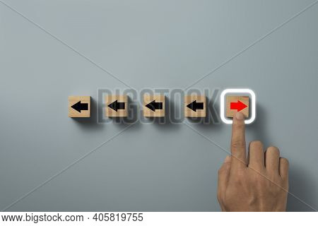 Disruption And Technology Transformation Concept , Hand Touching Red Arrow On Wooden Block Cube Move