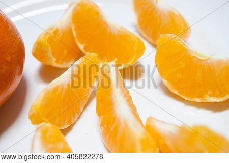 Orange Slice Isolated On White Background. Juicy Sweet Chunk Of Orange Or Segment Of Tangerine With