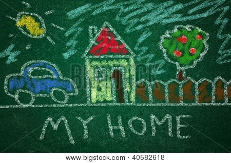Child Drawing On A green Chalkboard