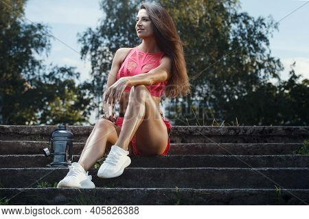 Outdoor Sport Beautiful Strong Sexy Athletic Muscular Young Caucasian Fitness Woman With Water Bottl