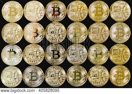A Photo Of Golden Bitcoins With Various Reflections. Isolated On A Black Background