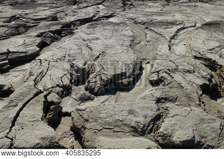 Water-washed Land. Cracked Crumbling Clay And Sandy Soil After The Snow Melts In The Spring Or Flood