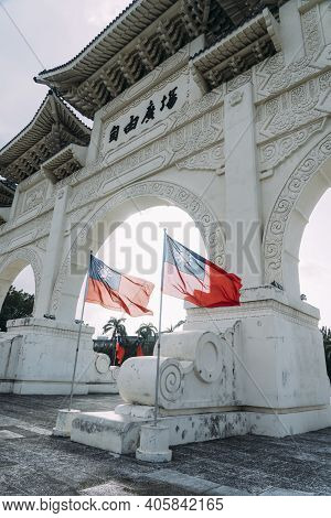 Close View Of Liberty Square Arch In Taipei With Flag Of Taiwan Waving In The Wind With Light Shinin