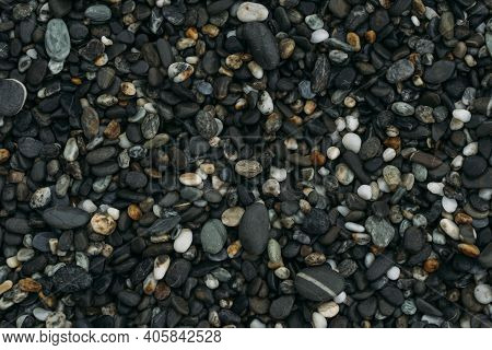 Beautiful Smooth Stones On Beach Filling The Frame.