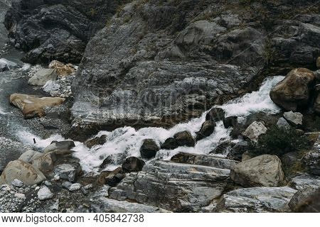 Rocky Waterfall In Flowing Down Into Small Rocky River, In Hualien Taiwan.