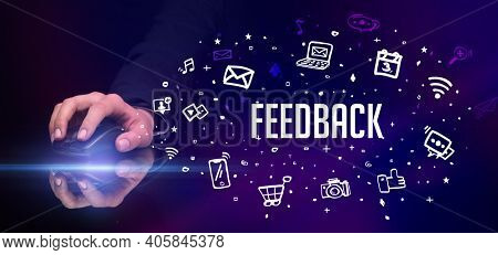 hand holding wireless peripheral with FEEDBACK inscription, social media concept