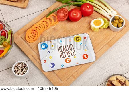 Healthy Tablet Pc compostion with HEALTHY RECIPES inscription, weight loss concept
