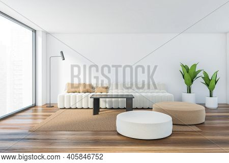 Light Living Room With Large White Sofa With Pillows, Plants And Cushions On The Wooden Parquet Floo