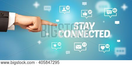 Close-Up of cropped hand pointing at STAY CONNECTED inscription, social networking concept