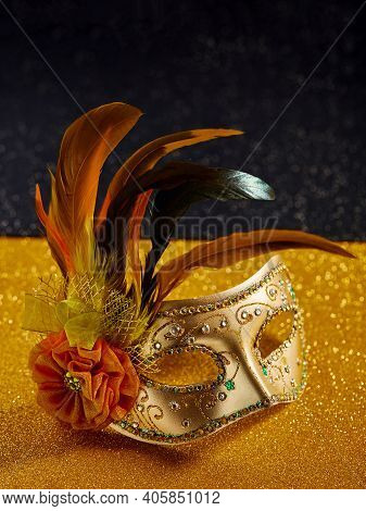 Festive, Colorful Mardi Gras Or Carnivale Mask With Feathers On Golden Background. Venetian Masks. P