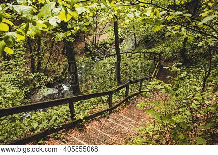 Hiking Trail In German Forest. Scenic Footpath With Steps And Wooden Railing In Rothaar Mountains In