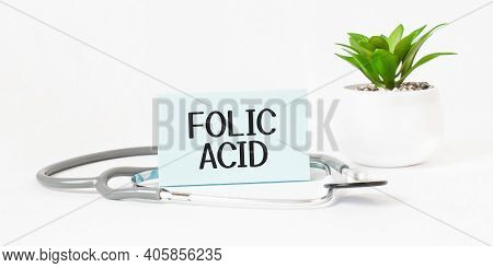 Folic Acid Word On Notebook,stethoscope And Green Plant