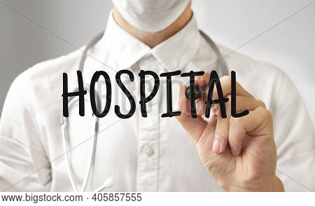 Doctor Writing Word Hospital With Marker, Medical Concept